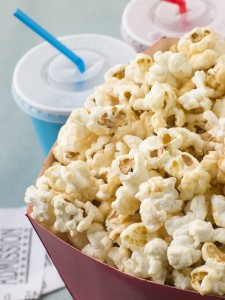2168449-bucket-of-popcorn-with-soft-drinks-and-cinema-tickets